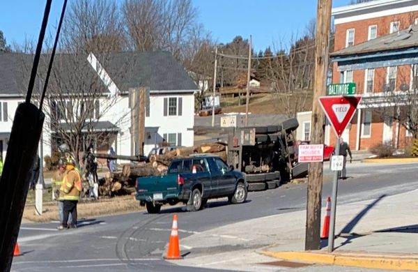 Log truck flips in Jefferson, PA