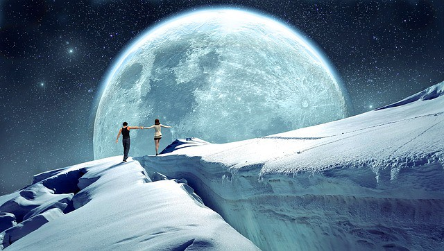 Supermoon with snow and Humans walking under it's immense glory