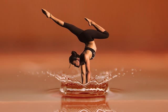 yoga pose with a water drop artistic perspective